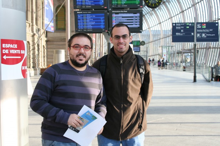 Jose and Fernando in the train station, after getting some maps in the information office